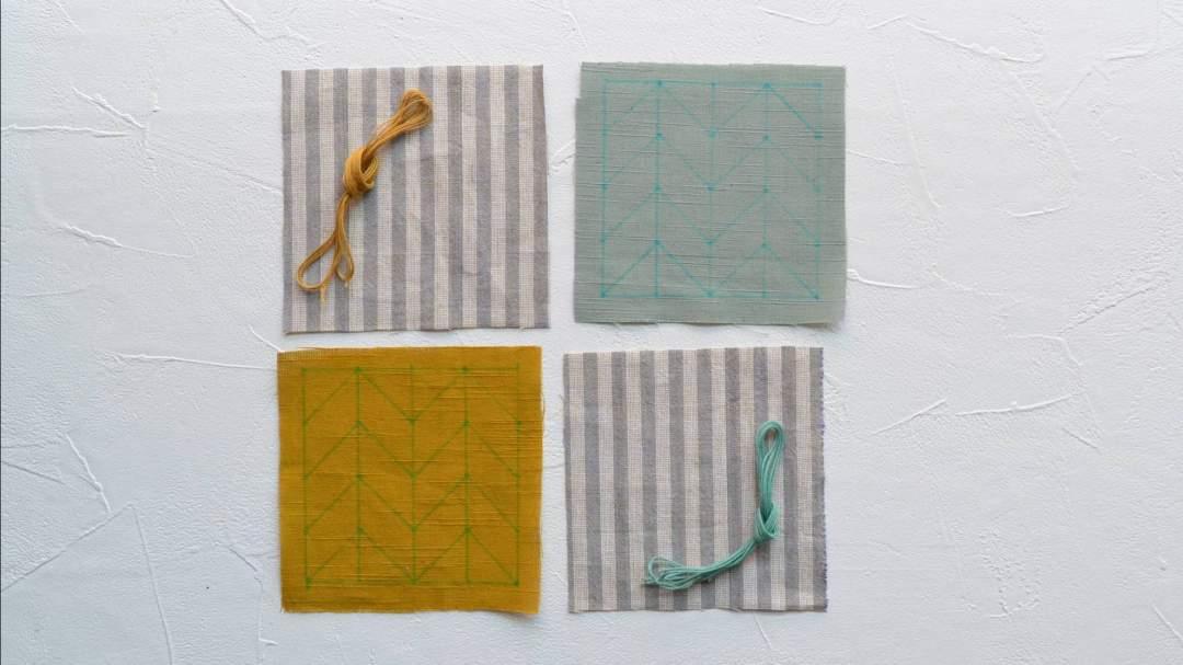 ▶会津木綿(下書き付き2枚、裏布2枚) *裏布はすべて統一の柄です。 ▶糸(2色×3本) ▶針1本 ▶作り方説明書 *下書きは水で消えるチャコペンシルで描いています。